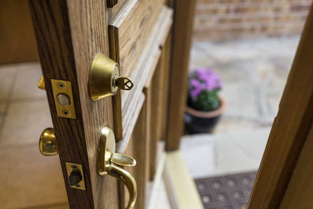 Front door open with key in lock to represent moving house